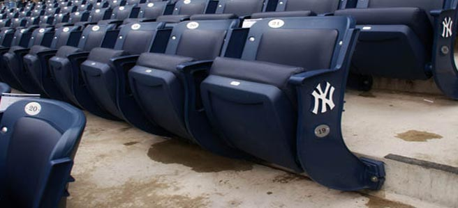 stadium seat covers protects bleacher seats at yankee stadium. Black Bedroom Furniture Sets. Home Design Ideas